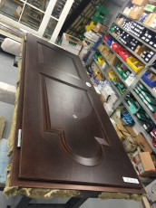 Fort Security Doors Replica Front Door With Okume Wood Finish In Assembly Area