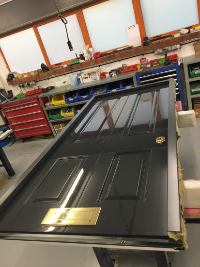 Fort Security Doors 4 Panel Front Door With Gold Embelishment In Assembly Area